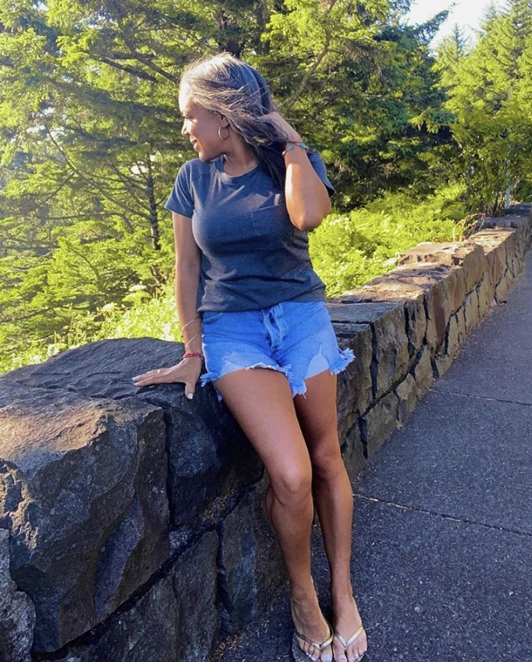 gray tee and denim shorts