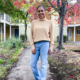 Beige turtleneck sweater and bootcut jeans outfit