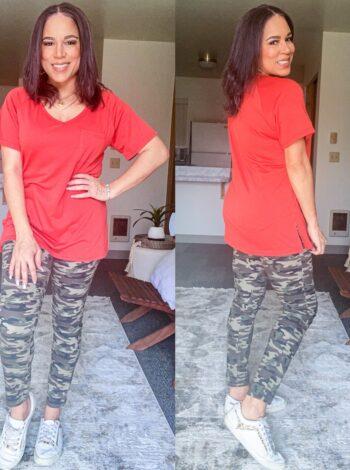 camo pants and orange tee